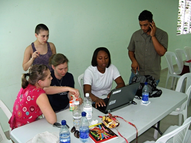 The Microfinance Student Team at work in Boca Chica. from left to right: Lauren, Natalie, Javonne, Isaac (translator), Rachel (standing)